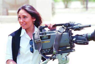 Pioneering Saudi movie director says keen to film back home