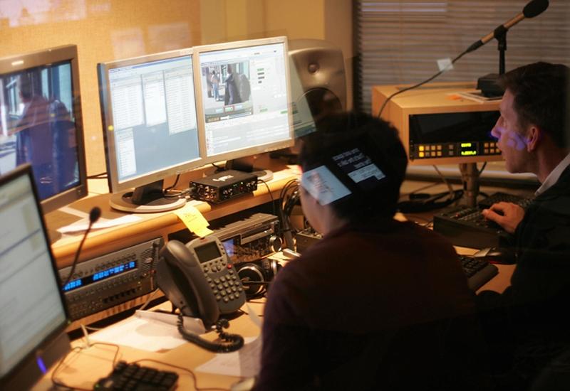 Staff perform editing work at AJE's Washington D.C. studio.