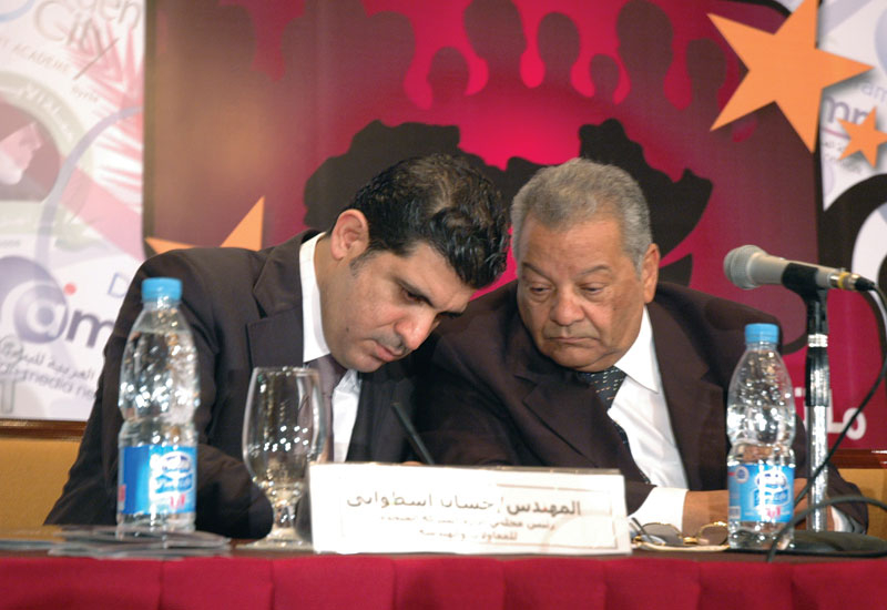 Mustafa Salamah (left) with APUTV president Ibrahim Abu Zekri.