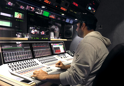 An audio operator at KTV works with the Calrec Summa audio console.