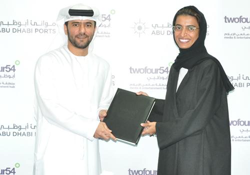Captain Mohamed Juma Al Shamisi and Noura al Kaabi at the signing ceremony.