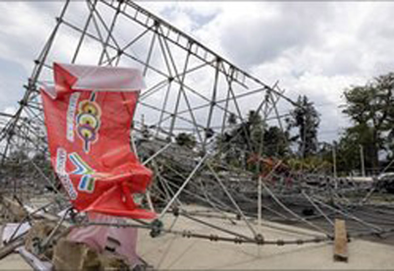 Scaffolding and light towers collapsed in the storm, injuring five people.