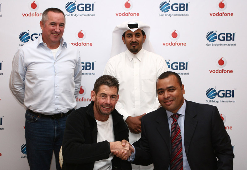 Vodafone Qatar CEO Graham Maher shakes hands with GBI CEO Ahmed Mekky after signing the cable landing deal.