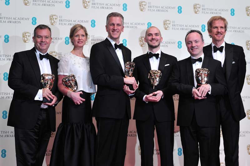 Neil Corbould, Nikki Penny, David Shirk, Chris Lawrence and Tim Webber pose with their awards for special visual effects for their work on the film 'G