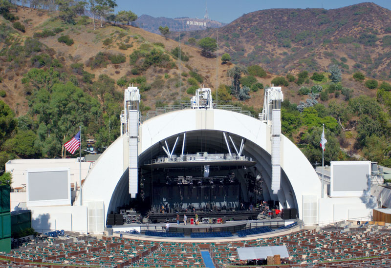 THE HOLLYWOOD BOWL (Los Angeles, USA) The Hollywood Bowl is known for its band shell, a distinctive set of concentric arches that graced the site from 1929 through 2003, before being replaced with a somewhat larger one beginning in the 2004 season. The shell is set against the backdrop of the Hollywood Hills and the famous Hollywood sign to the Northeast. The
