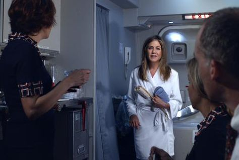 The teaser shows Aniston on board an Emirates flight.