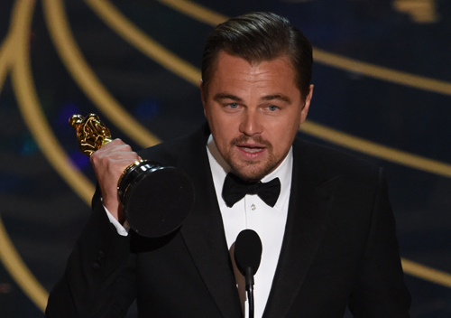 DiCaprio picks up the Best Actor honour at the 88th Academy Awards.