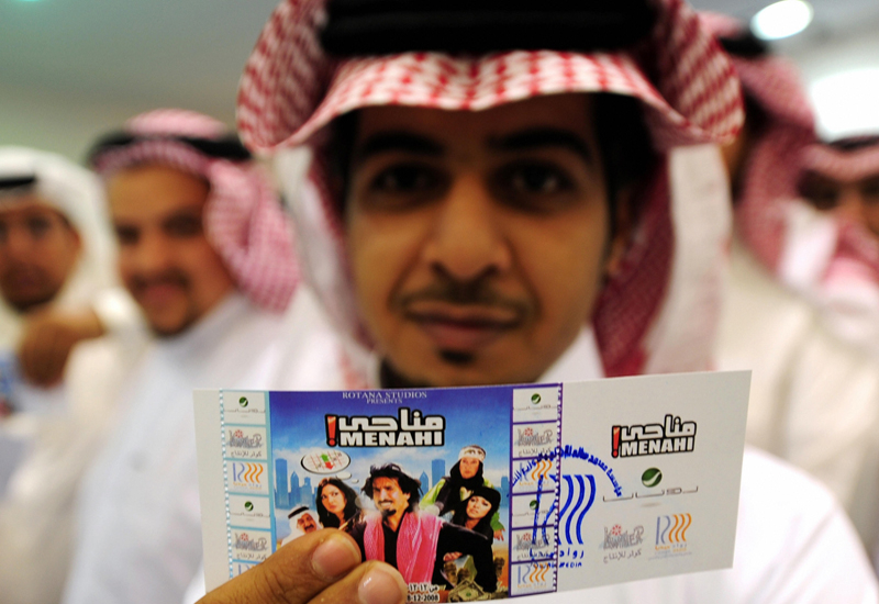 A viewer shows off his ticket to watch Menahi on the big screen.