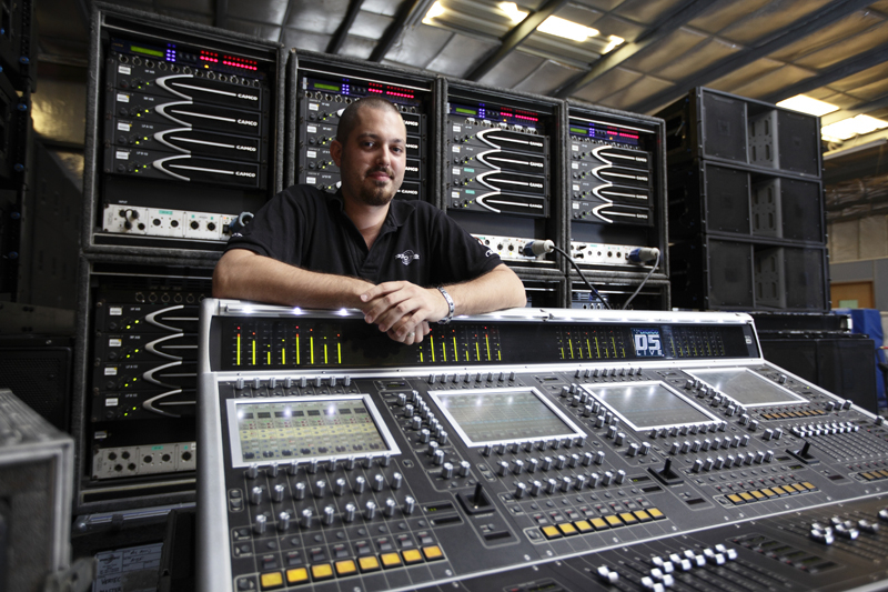 Protec head of audio Edward Ross, pictured with the company's recently acquired DiGiCo D5 mixing desk.