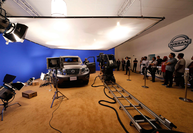 The makeshift studio featured a blue screen and a motion control robot arm.Arri lights illuminated the set.
