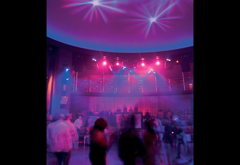 Projectors are positioned above the main dance floor.