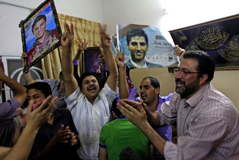 The family and friends of Mohammad Assaf celebrate after he won the final of the Arab Idol competition. (AFP/Getty Images)