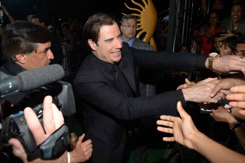 John Travolta greets fans before the IIFA Awards at Raymond James Stadium on April 26 in Tampa, Florida.(Photo: Gustavo Caballero/Getty Images)