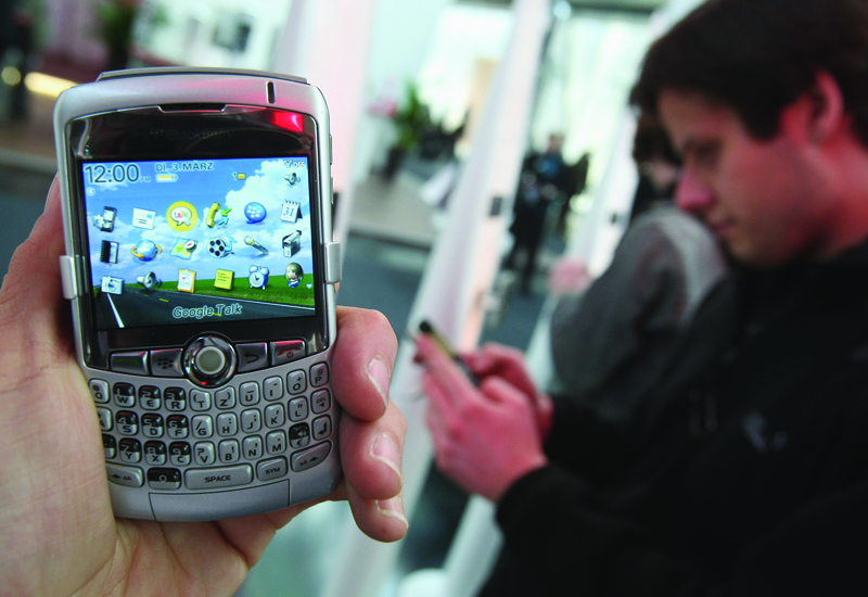 A senior Etisalat exec has again denied claims a Blackberry software patch issued was spyware.