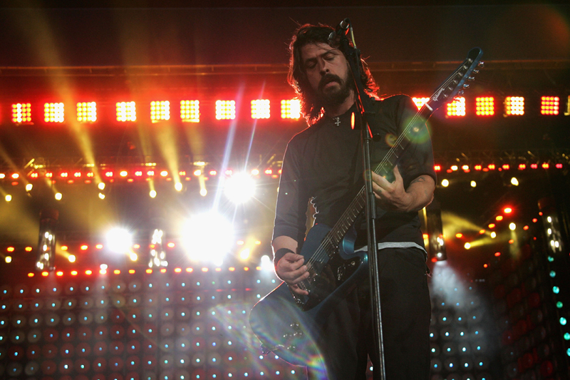 Foo Fighters on stage at Live Earth London. The 2007 concert series showcased sustainable lighting technologies.