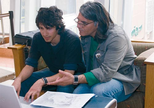 Iranian filmmaker Ali Shah Hatami reviews the storyboard with his son.