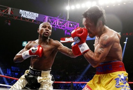 Floyd Mayweather Jr. exchange punches with Manny Pacquiao during their welterweight unification championship bout, May 2, 2015. (Getty Images)
