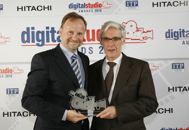 Newtec CEO Serge Van Herck (left) and CTO Dirk Breynaert pictured with one of the company's two Digital Studio Awards that it received this year.