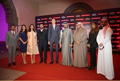 Waleed Al Sayed and Sam Barnett with celebrities and members of the team