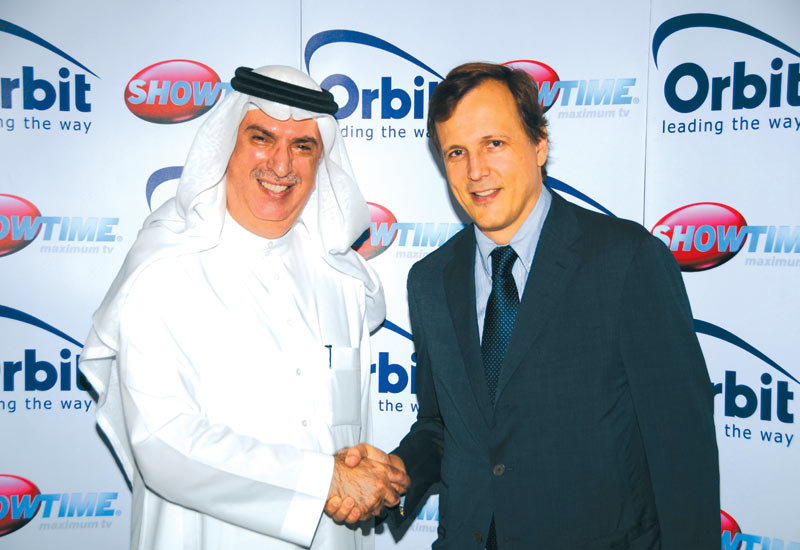 Samir Abdulhadi (left) and Marc-Antoine d?Halluin pictured at the signing of the deal that will create the largest pay TV operator in the Middle East.