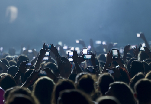 Are we becoming a generation of phone-filming addicts? (Image: Shutterstock)