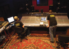 SAE students pictured in the recording studio.