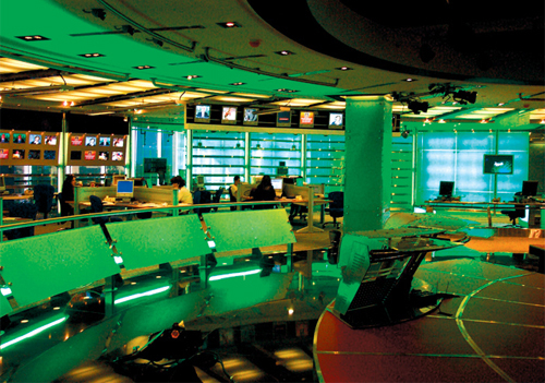 A look at the old studio with smaller monitors and fluorescent lighting and the new one that uses LED colour changing lights and Barco projectors.