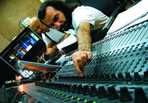 Farzin (foreground) at work in the Pro Sound Design studio.