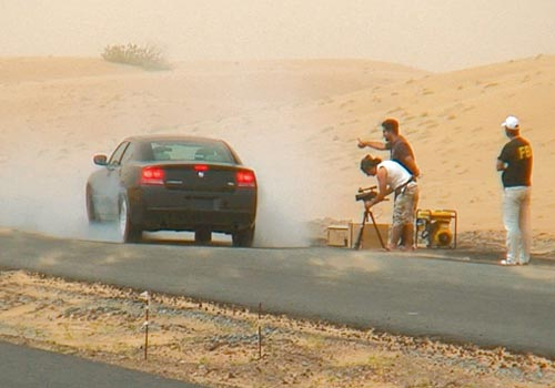 A Dodge Charger performs a burnout for Bouri's self funded film The Twelfth Task; Bouri claims that without funding, the Dubai film industry is also h