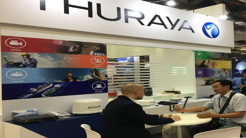 A visitor engaged with Thuraya's delegate to gain insight into the new products on display.