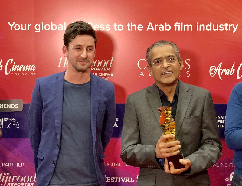 DIFF Chairman Abdulhamid Juma presented the award by Hollywood Reporter's Alex Ritman