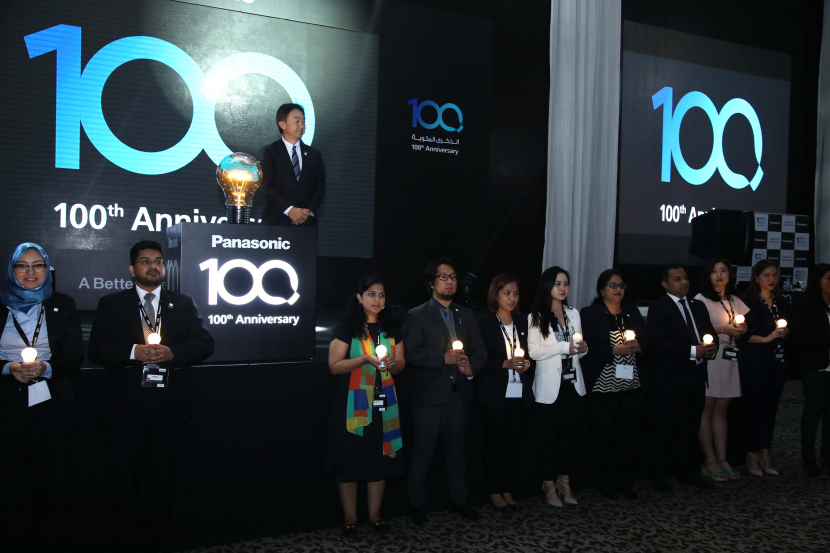 Managing Director Hiroki Soejima lights a ceremonial bulb in celebration of Panasonic's 100 years of operation.