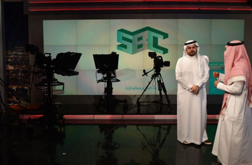 Fahad Shlayel Director General of the Production and Programmes (right) talking to a staff employee at the studio of the new channel Saudi Broadcasting Corporation SBC in Riyadh.