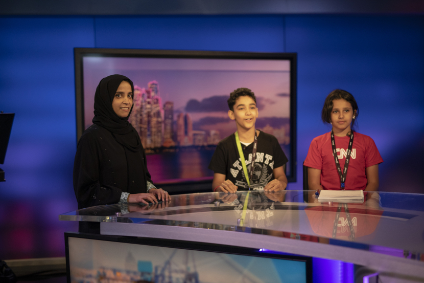 H.E. Maryam Eid AlMheiri, CEO of Media Zone Authority – Abu Dhabi and twofour54 and children from twofour54's annual Summer Camp enjoying a session at the CNN Headquarters in Abu Dhabi