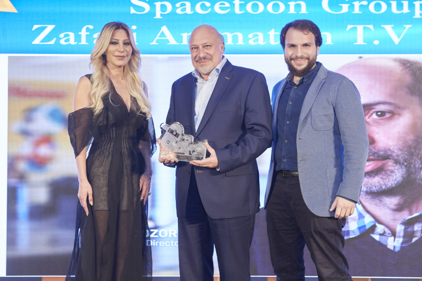 Fayez Al Sabbagh, the President of Spacetoon Group and Kamel Weiss, Director Strategy Business Development accept the award from Rola Tabet, Managing Director 7 Production, Gold Sponsors at the #DSawards