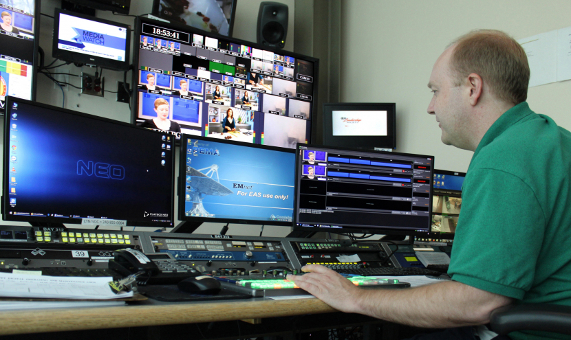 Jonas Bowen, master controller at WLVT-TV operating the PlayBox Neo playout system.