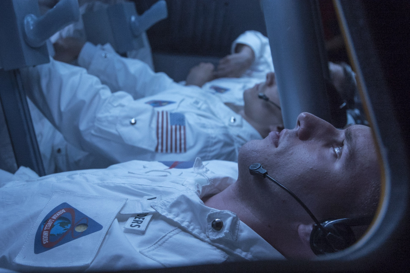 Reenactment of Astronaut Bill Anders foreground in the Apollo 8 control module on December 23 1968.
