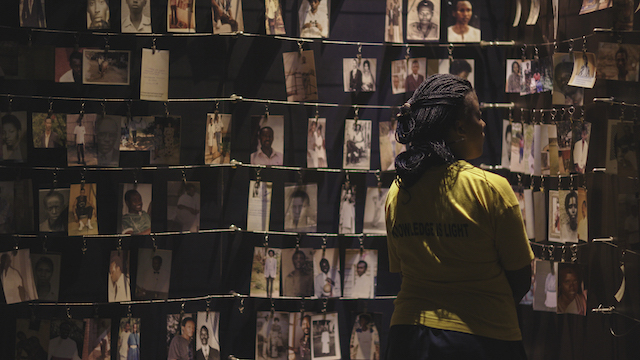 A visitor looks at the photo exhibit at the Kigali Genocide Memorial which documents the 1994 Genocide against the Tutsi population in Rwanda