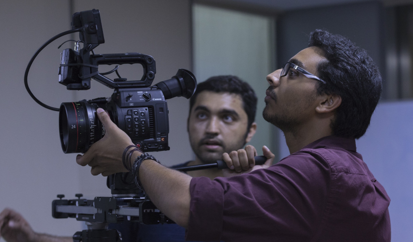Faisal Hashmi (in the background) on set during the filming of 'Wicken'