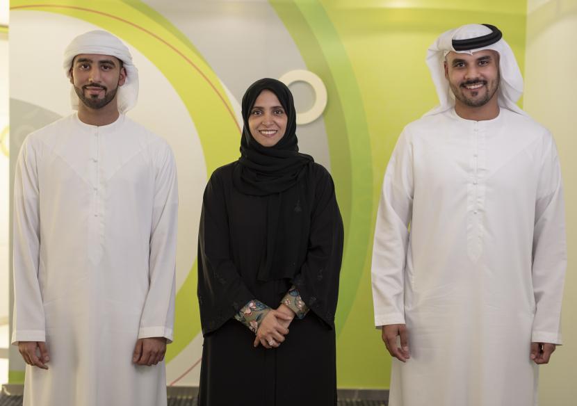Mohammed AlBlooshi and Omar Muflahi with HE Maryam Eid AlMheiri.