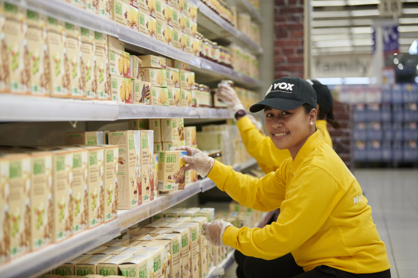 Merly Ann Alerge, customer service officer at VOX Cinemas replenishes stock at Carrefour.